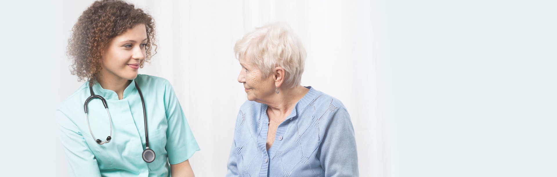 old woman having an appointment with her caregiver
